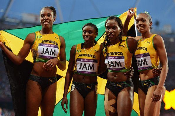 Christine Day, Rosemarie Whyte, Shericka Williams, Novlene Williams-Mills of Jamaica celebrate winning bronze in the Women's 4 x 400m Final on Day