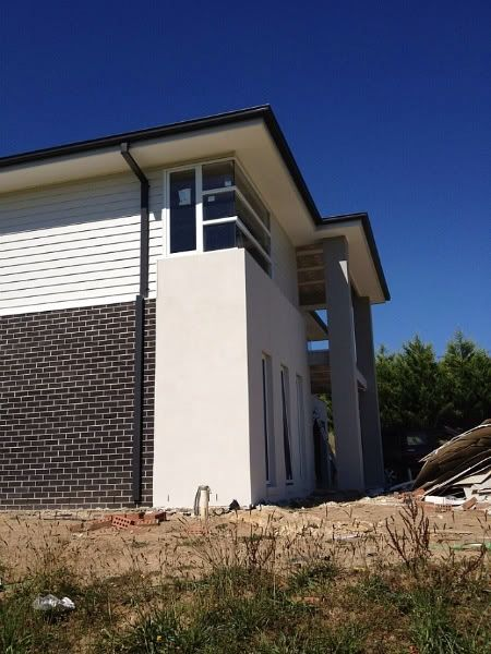 Colorbond surfmist weatherboards and render new house for Weatherboard garage designs