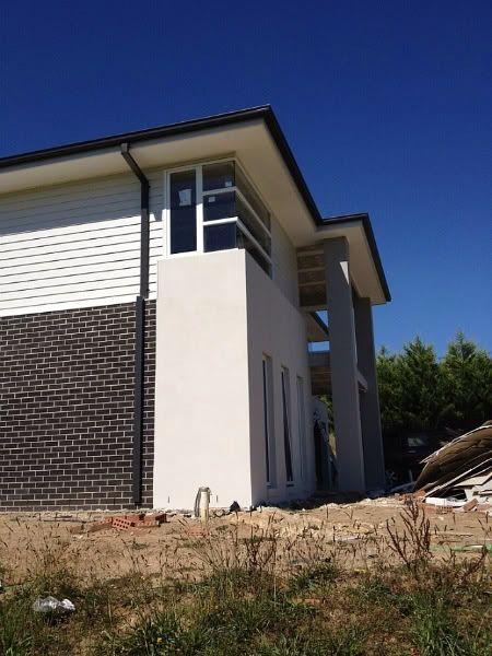 Colorbond surfmist weatherboards and render new house for Weatherboard garage designs