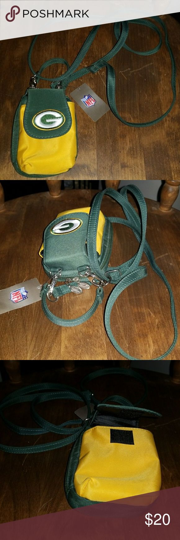 NFL green bay packers pouch Green bay packers little crossbody or hand held phone case,cigarette case,long shoulder strap,and hand carry strap ,one outside pocket ,2 inside pockets, zip zip closure, one id slot on back. Green bay packers Bags Mini Bags