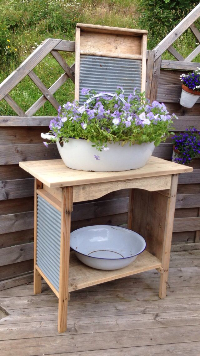Two old wash boards turned into a small bench, with enamel wash tubs and a third wash board as decor.