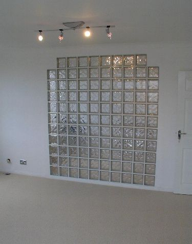Glass brick wall used as a room divider.