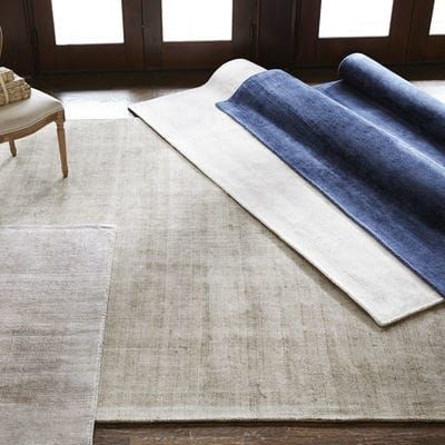 To complement or to contrast? Don't worry, our solid taupe rug is effective either way. Hand-woven of 100% viscose for a silken feel, low profile and pleasant sheen, it's perfectly suited for bedrooms or formal areas—whether subtly enhancing your decor or making it really stand out.
