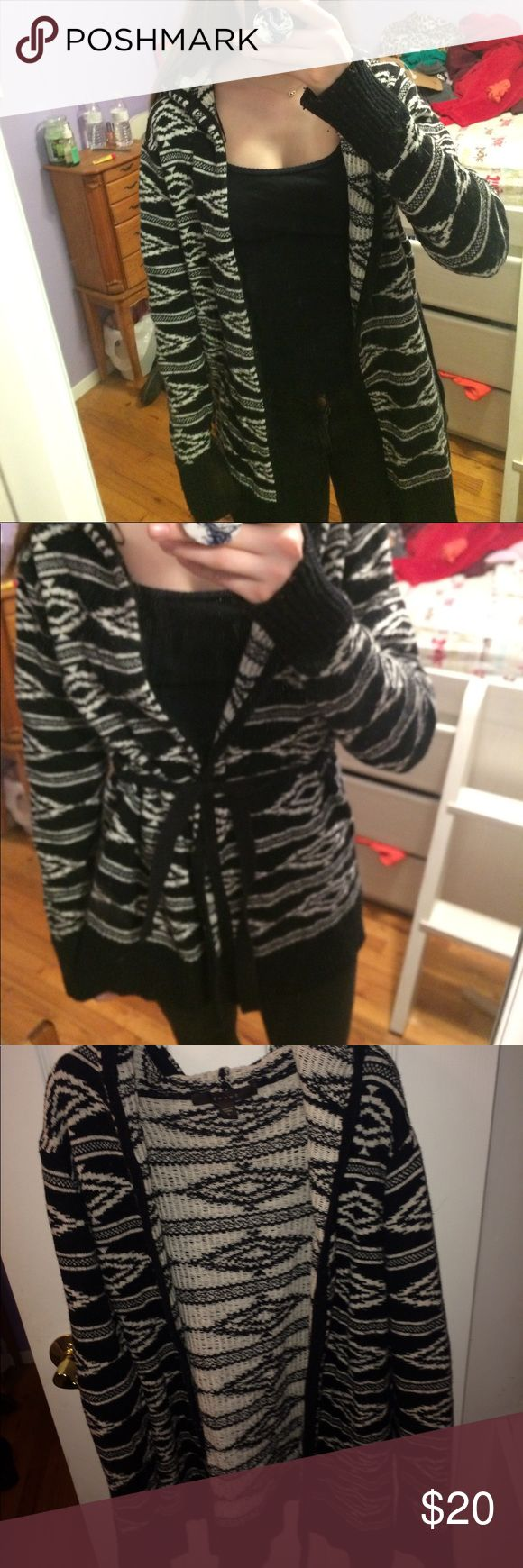 Tribal print cardigan Hooded thick black and white tribal print cardigan. Comes with detachable black cloth belt. Lightly worn good condition. Size large but I normally wear a small but it is a comfortable fit loose fit. Will be washed before sold Fever Sweaters Cardigans