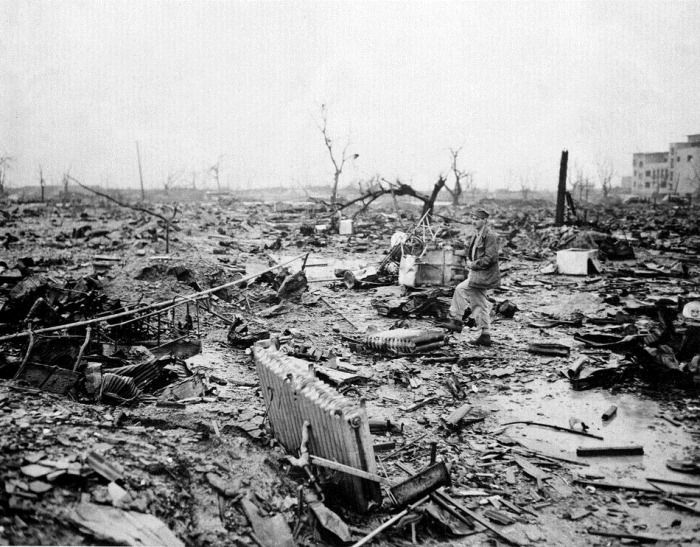 (Hiroshima after the bombing in WWII) // How did the Japanese man feel about his surroundings? // The Japanese man who was walking in Hiroshima after the war, felt depressed seeing all the buildings destroyed and plants dead.