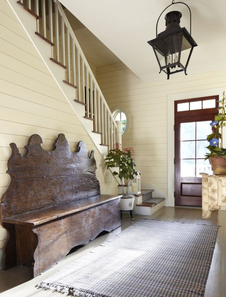 Stunning farmhouse entry - love the oversized light fixture and the shiplap…
