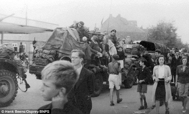 British Guards Armoured division driving through Eindoven en route to Arnhem, Around 2,500 soldiers were left on the wrong side of the Rhine but were heroically rescued by boat in a night-time evacuation under the noses of the Germans
