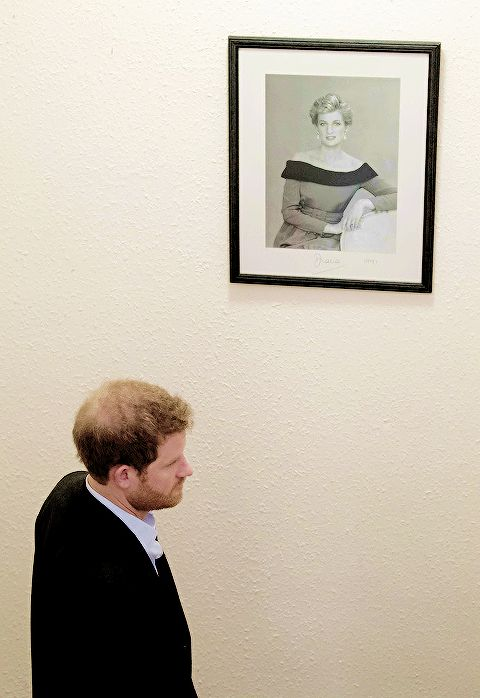 "princeharrydaily: "" Prince Harry walks past a photograph of his mother, Diana, Princess of Wales, who visited the charity in 1991, on a visit to the Leicestershire Aids Support Service (LASS) 