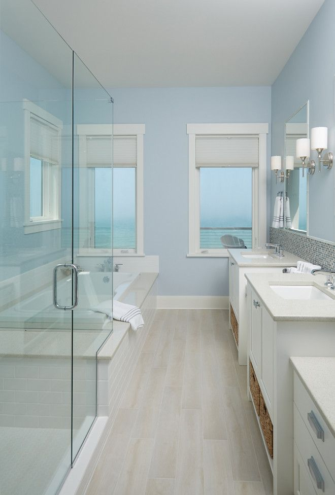 the master bathroom tile simulates the hardwood floor in the main area of the house