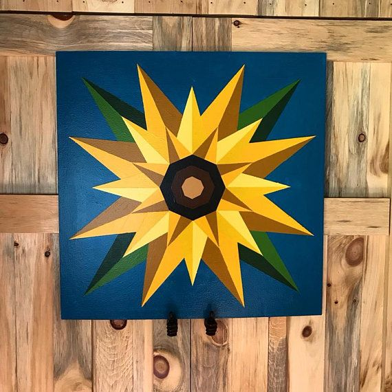 2ft x 2ft Sunflower Flag Barn Quilt OTHER SIZES AVAILABLE, PLEASE MESSAGE FOR DETAILS. If you are interested in this pattern in a different color variation, we would love to make one for you! Please message us today for your custom barn quilt. 1 month processing time. Shipping is