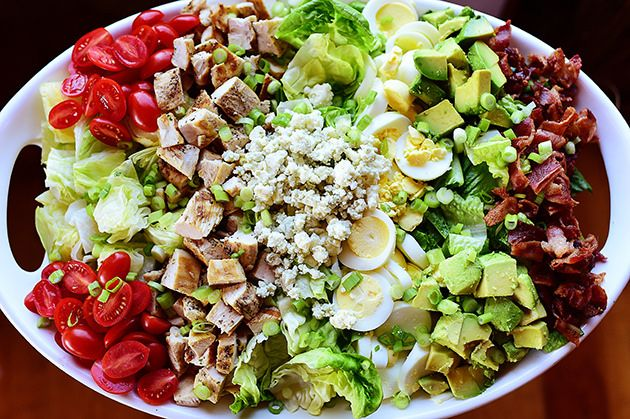 Cobb Salad--2 whole Boneless, Skinless Chicken Breasts..  Salt And Pepper..  Olive Oil.. 2 heads Romaine Lettuce.. 1 head Iceberg Lettuce.. 2 heads Bibb Lettuce.. 6 whole Hardboiled Eggs.. 1 pound  Bacon.. 8 ounces Tomatoes.. 2 whole Avocados.. 1/3 cup Blue Cheese Crumbles..  Black Pepper..  Blue Cheese Dressing