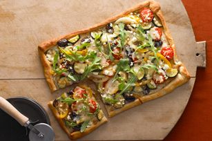 Rustic Veggie Pizza recipe    Skillet-browned onion, peppers and zucchini. Melty mozz and feta cheese. Just scatter fresh arugula on top after baking for a veggie-ful treat.