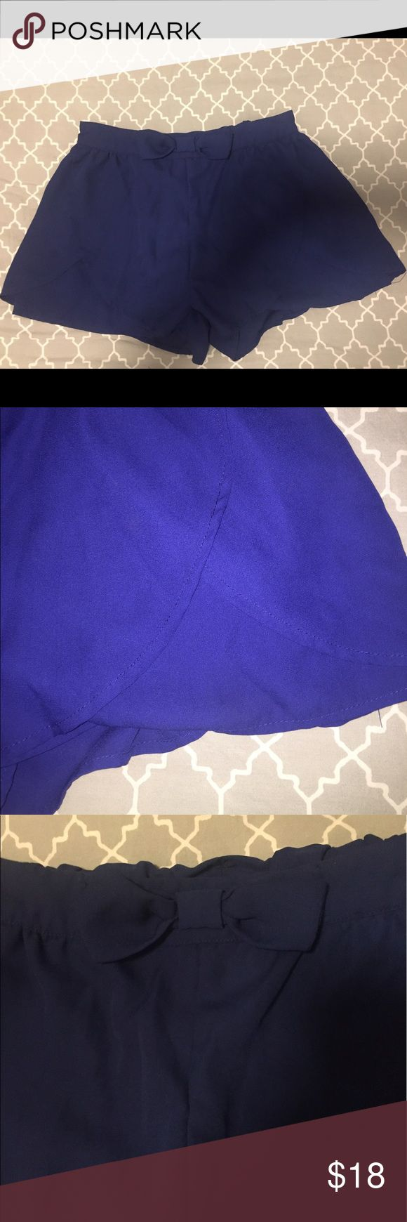 Royal blue shorts These shorts are a perfect royal blue with a bow detail on the waistband. They also are really stretchy/loose fitting which make them very comfortable for the summer. Francesca's Collections Shorts