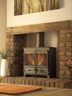 wood burning stove with tv above - Google Search