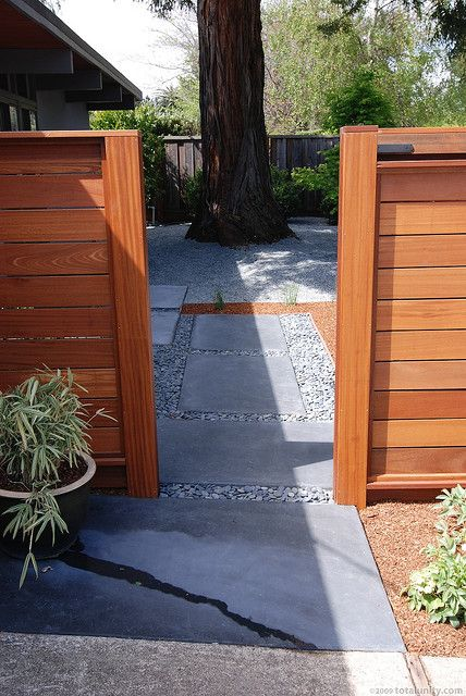 Very clean lines on fence, use of patio stones and pea gravel