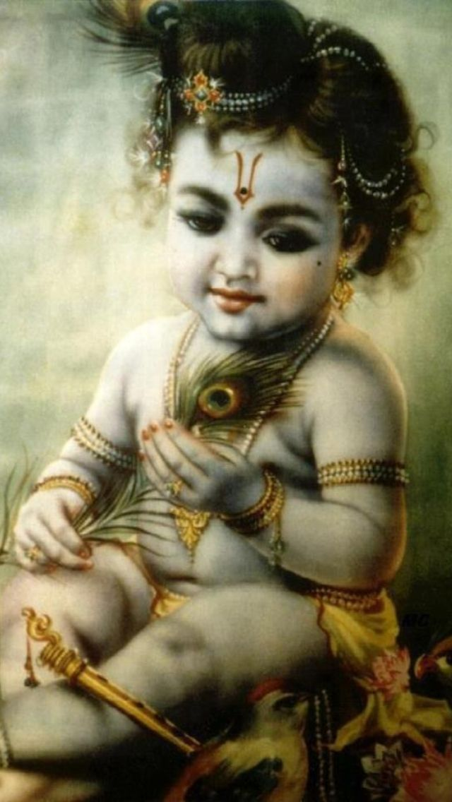 Baby Krishna with a peacock feather