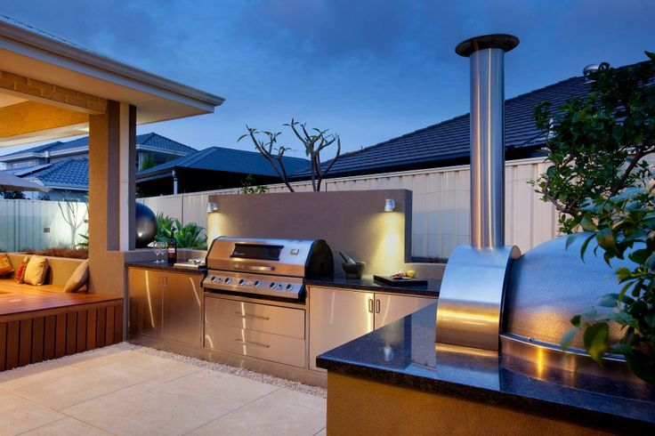 Outdoor kitchen with BBQ and pizza oven