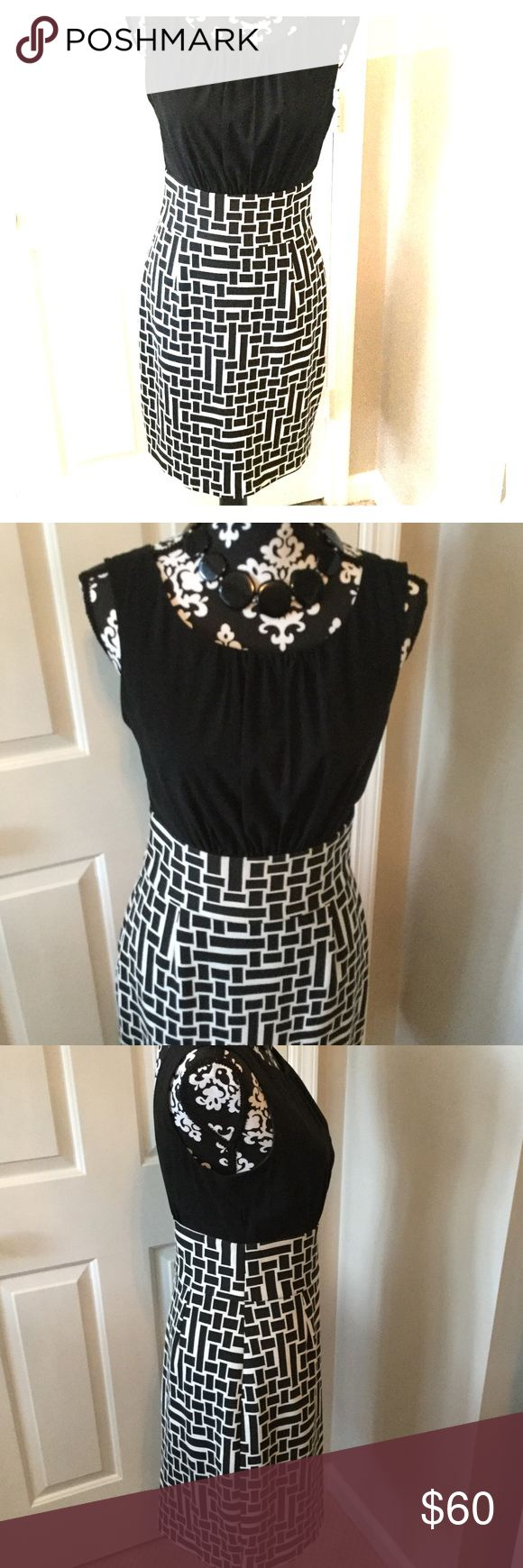 Gorgeous black and cream patterned dress Dress this one up or down.very smart looking dress. Back zip. Beautifully gathered bodice. Trina Turk Dresses