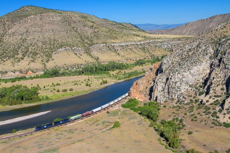 https://flic.kr/p/UAypJj   Exiting Tombard   Two SD70ACe's lead Montana Rail Link's 840 Helena Local eastbound as it exits Lombard Canyon along the Missouri River. The local is on the approach to a spur/sidetrack called Stanley. Across the Missouri is the right-of-way of the Milwaukee Road Pacific Extension.