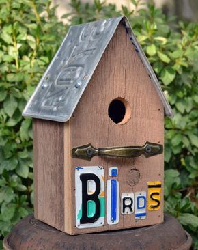 All the rustic finds add charm to this Primitive birdhouse. Made from barnwood with a recycled license plate for the roof. Recycled license plate