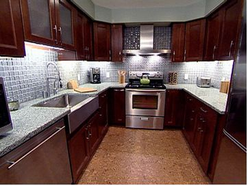 Green kitchen chocolate brown cabinets recycled glass for Green and brown kitchen ideas