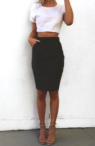 White crop top & black skirt.