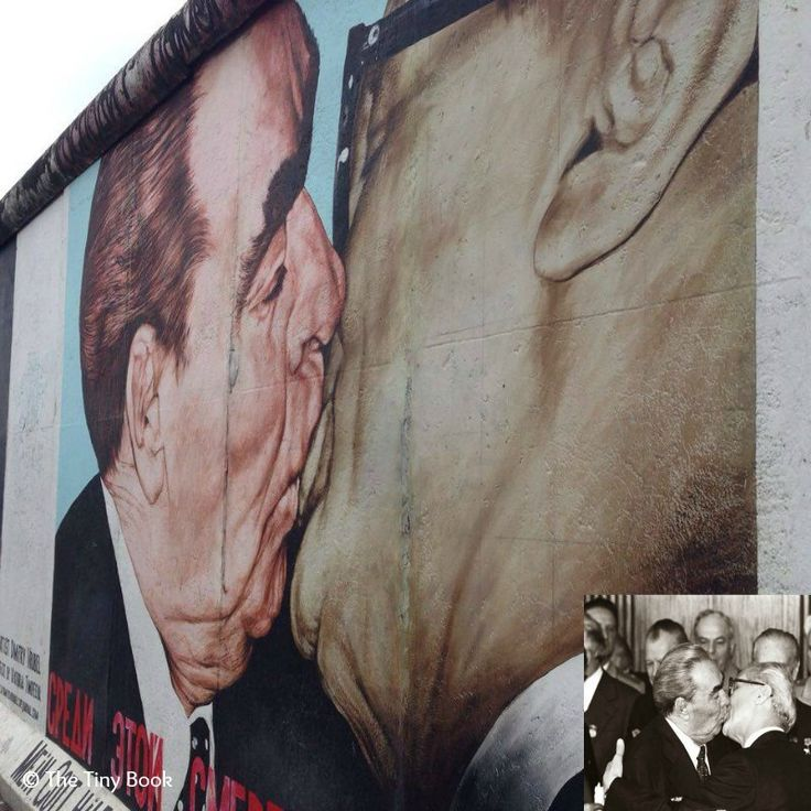 """Painting: My God, Help Me to Survive This Deadly Love (Also known as """"Fraternal Kiss"""" by Dmitri Vrubel. This is one of the best known works of graffiti art on the Berlin Wall In the corner: Socialist Fraternal Kiss between L. Brezhnev and E. Honecker, 1979."""