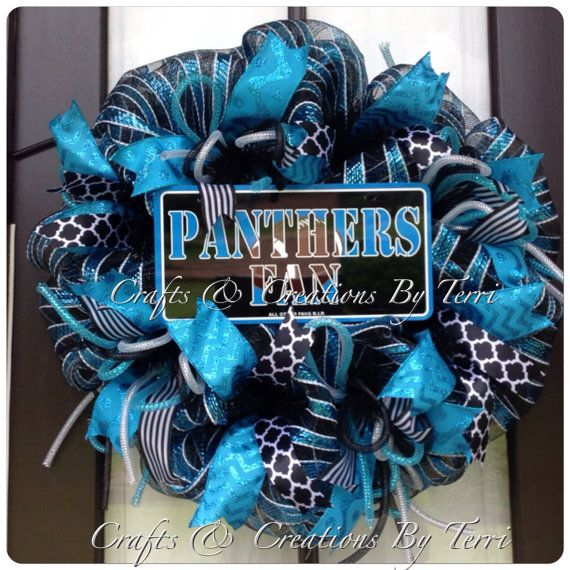 Deco Mesh Wreath Carolina PANTHERS Football Door by CreatedByTerri, Follow Created By Terri/Crafts & Creations By Terri www.facebook.com/CraftsandCreationsByTerri  www.etsy.com/shop/CreatedByTerri Instagram @ CreatedByTerri  Twitter @ designsbyterri #craftsandcreationsbyterri #createdbyterri #etsy #doorwreaths