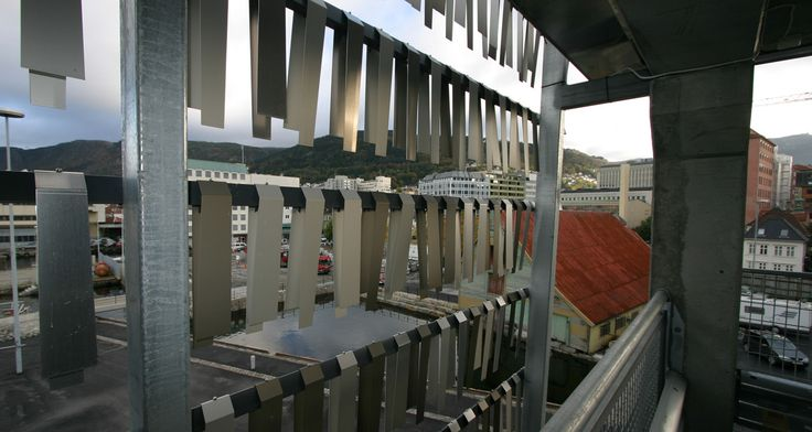 "Parking garage Bergen - with aluminium ""fish"" swinging in the wind- like the Norwegian wooden stands for drying fish"
