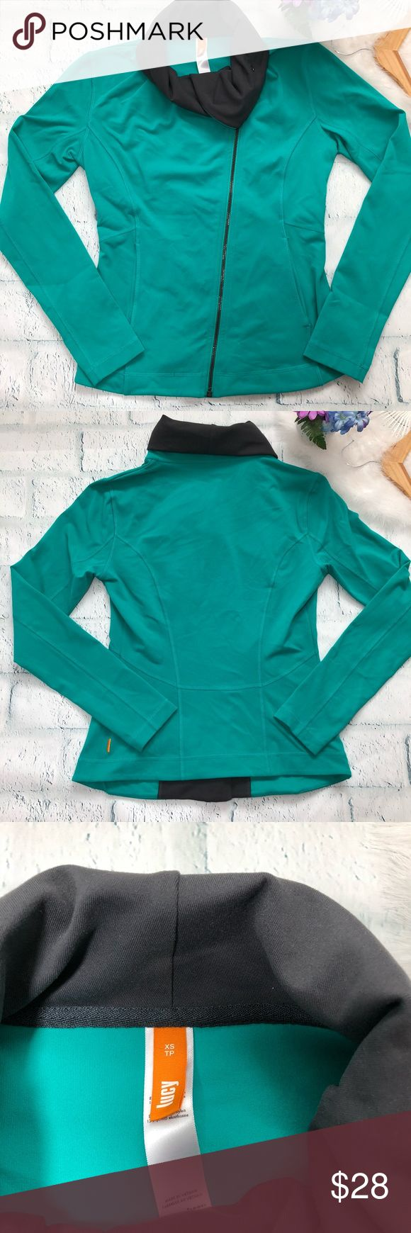 """Lucy Hatha Green  zip up sweatshirt size XS Lucy Hatha sweatshirt. Assimetric zipper . Zip up. Size XS. Snap closure Button at neck. Front pockets. Gray collar. Color is green . In pre loved conditions.  ALL MEASUREMENTS ARE APPROXIMATE AND LAYING FLAT: 🔸LENGTH: 22.5"""" 🔸PIT TO PIT: 17.5"""" 🔸WAIST: 15"""" 🔸 SLEEVES: 24.5"""" FEEL FREE TO ASK QUESTIONS  I DO NOT TRADE Lucy Tops Sweatshirts & Hoodies"""