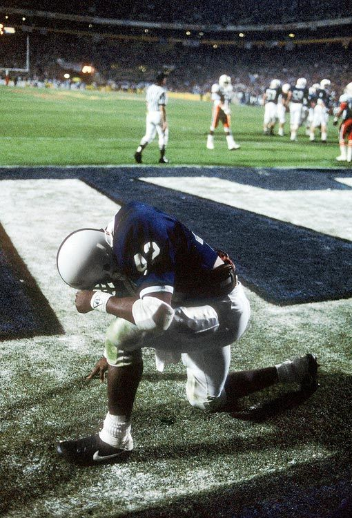 Penn State running back D.J. Dozier kneels in prayer after scoring what would be the game-winning touchdown on a 6-yard run in the middle of...