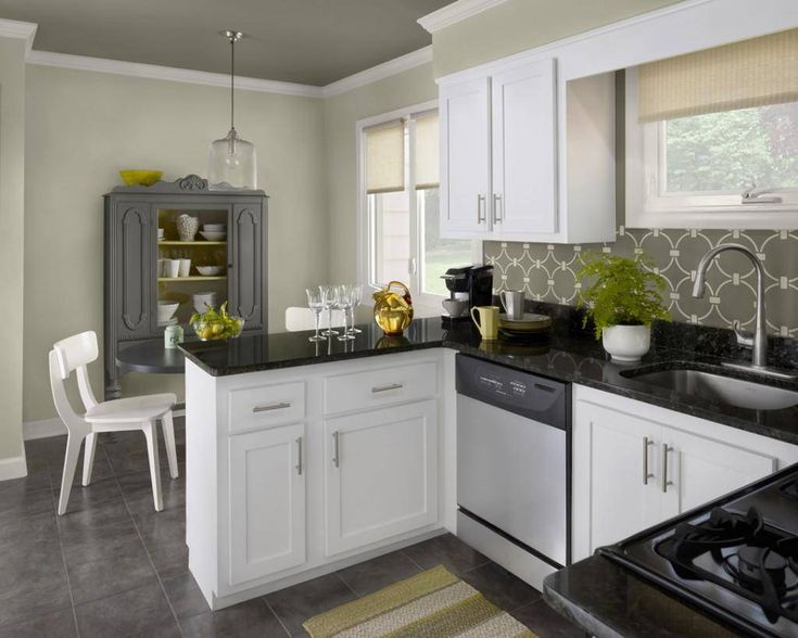 classic black and white kitchen set with gas stove and white chair