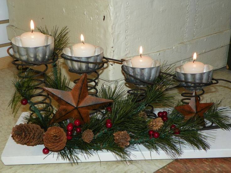 Vintage Jell-O Mold for Christmas Candle Holder put into a cluster of 4 bed springs. Pine garland with Red berries & barn stars