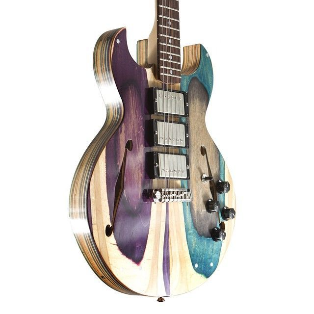 Prisma guitars made from recycled skateboards