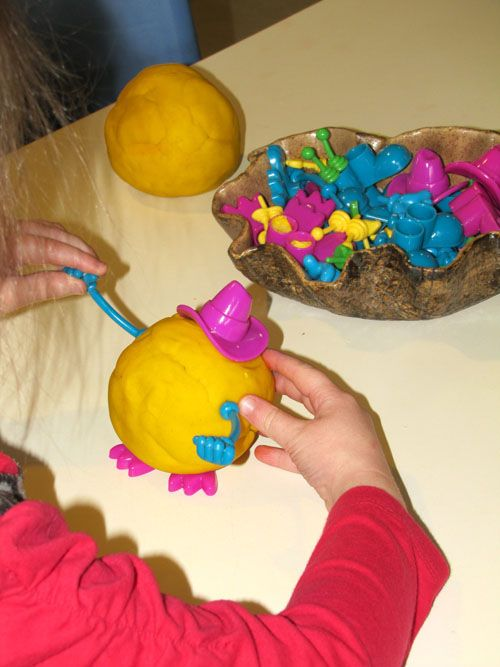 "We like adding Mr Potato Head body parts to play dough too ("",)"
