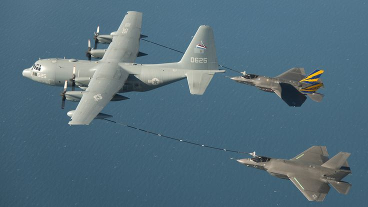Lockheed Martin KC-130 Hercules refueling two F-35As