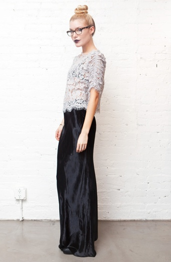 FALL STYLE - a top bun and glasses pair perfectly with a lace blouse and black silk maxi skirt via http://www.poppynyc.com