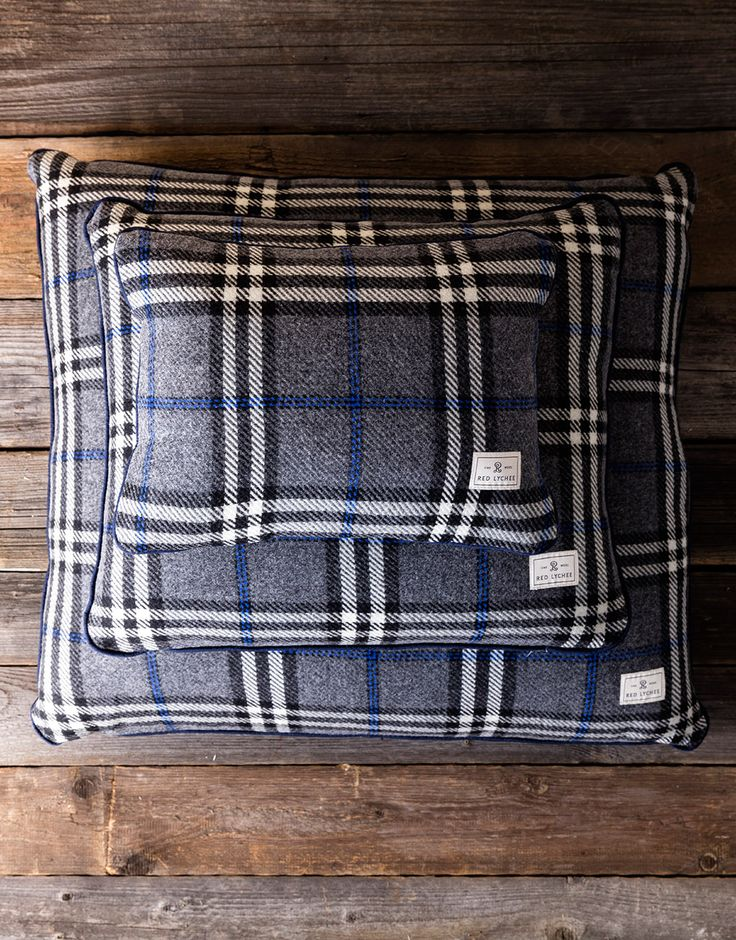 Red Lychee Ambassador Pillow cases are crafted in a plaid and finished with navy blue trims. They come with a fluffy and springy pillow inserts.