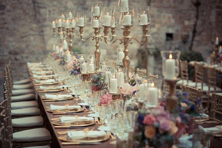 A amazing picture of the table set up with the tall gold candelabras