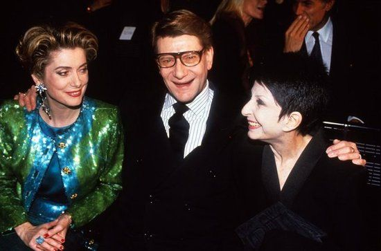 Yves Saint Laurent: Yves Saint Laurent with Catherine Deneuve and Zizi Jeanmaire at the YSL fashion show in Paris in January 1988.