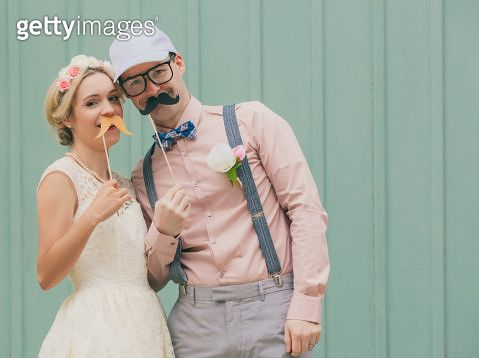 Funny couple with mustaches on wedding day - gettyimageskorea