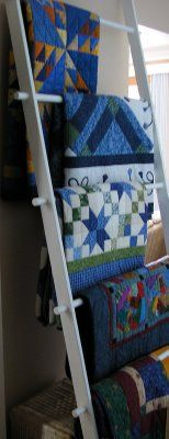 quilt ladder diy (I would make the dowels/rungs easily removable to facilitate removal and replacement of the quilts on display. We are supposed to sit on them, aren't we, Mary Ellen? You said it was OK. )