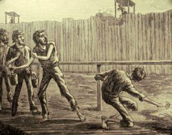 "The deadline that kept prisoners back from the walls of the stockade was marked by a simple fence. Prisoners who crossed the line were shot by sentries who sat in ""pigeon roosts"" located every 90 feet along the wall. The man in this image was shot reaching under the fence as he tried to obtain fresher water than was available downstream. (Andersonville National Historic Site)"