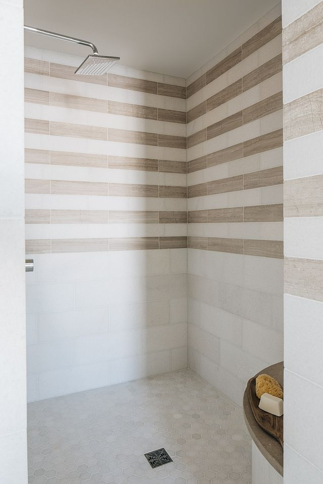 Shower Tile I Loved Creating The Stripe Pattern In The Shower To Look Like Wallpaper Above A Chair Rail The Shower Tile Coastal Farmhouse Shower Tile Patterns