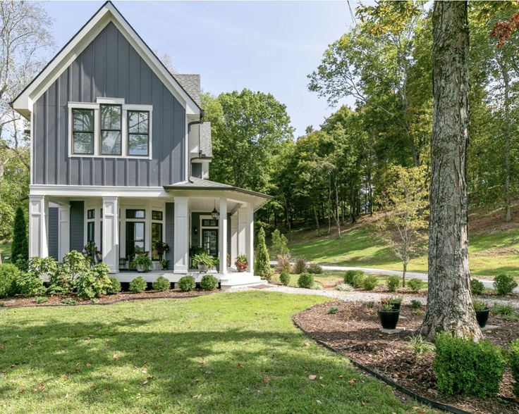 Large 2story home with charming window details and porch