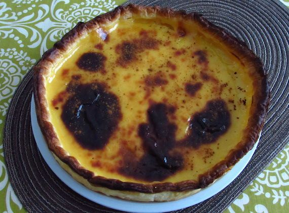 Portuguese egg pie | Food From Portugal. A delicious typical Portuguese sweet, puff pastry pie filled with a cream confectioned with egg yolks, sugar, cinnamon stick, cornstarch flour and lemon peel, garnished with cinnamon powder. http://www.foodfromportugal.com/recipe/portuguese-egg-pie/
