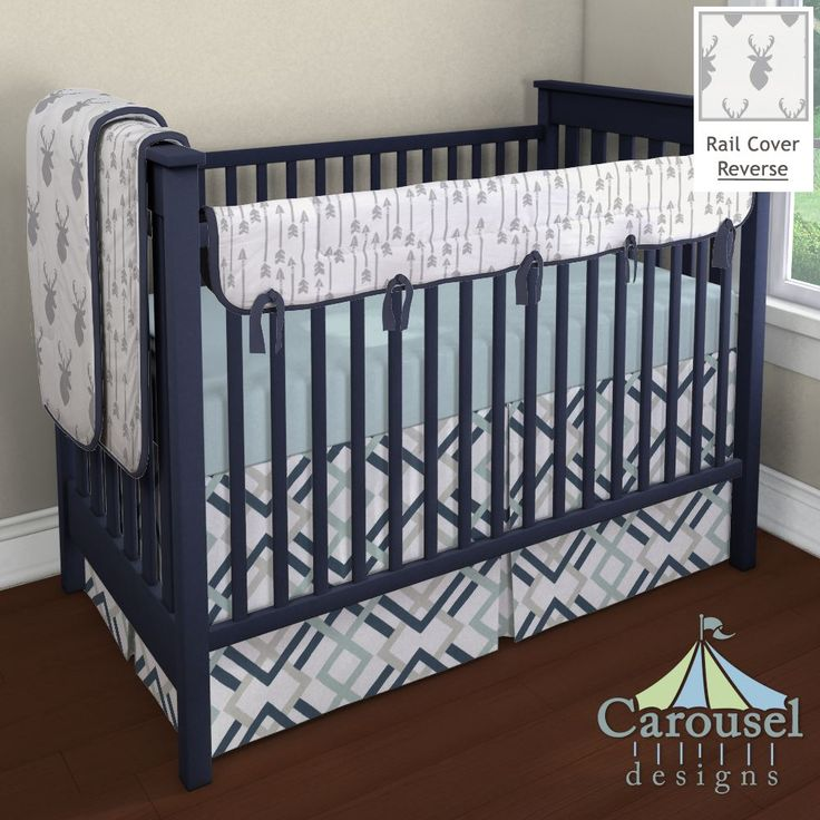 Crib bedding in Silver Gray Flying Arrow, Silver Gray Deer Head, Solid Navy, Solid Robin's Egg Blue, Navy and Gray Geometric. Created using the Nursery Designer® by Carousel Designs where you mix and match from hundreds of fabrics to create your own unique baby bedding. #carouseldesigns