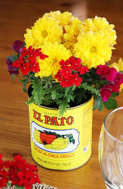 Mexican flower pot  cut 2 inch squares of colorful tissue paper to spread on the tables around center piece.