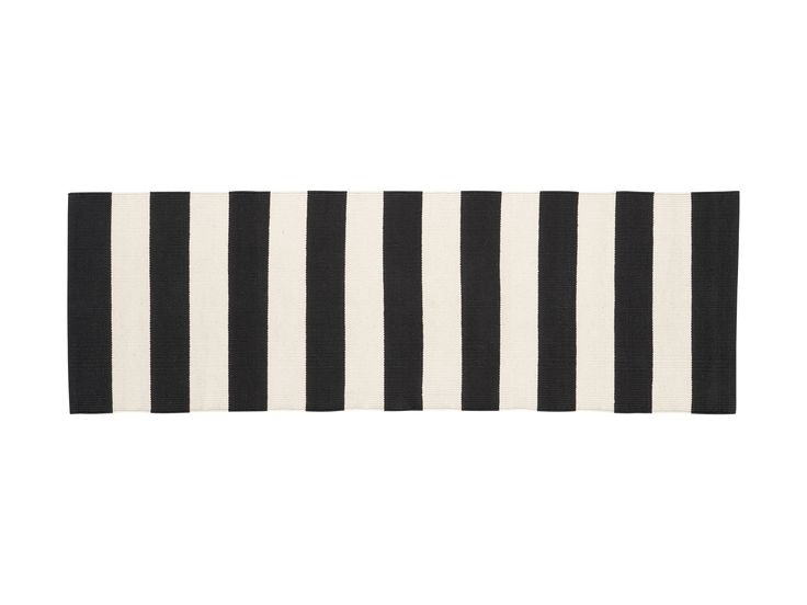 Garth suggests hanging a graphic runner on a bare wall, Olin 2' x 6' Runner in Black, crateandbarrel.com #home #decor #design