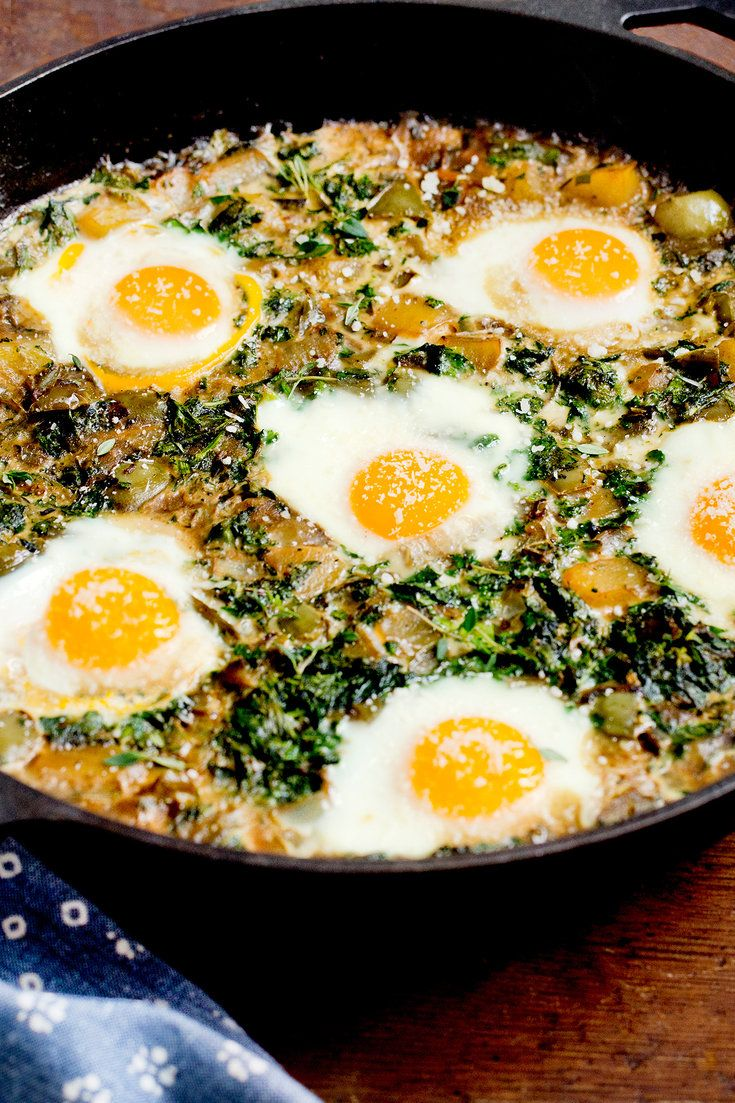 North African shakshuka, eggs baked on a vegetable stew, is popular throughout the Middle East and has become a brunch staple in New York. Traditionally, it's a tomato-based mixture, reflecting the Mediterranean market. But there are no rules. Here's an earthy green version made with broccoli rabe, potatoes and peppers. (Photo: Rikki Snyder for The New York Times)